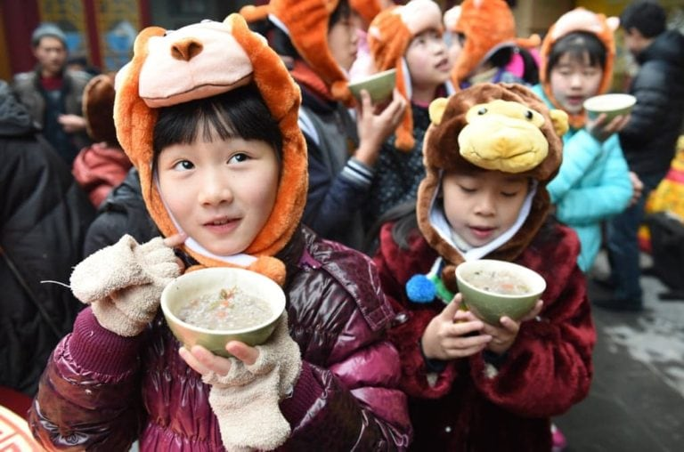 Chinese children enjoying the Rice Porridge Festival