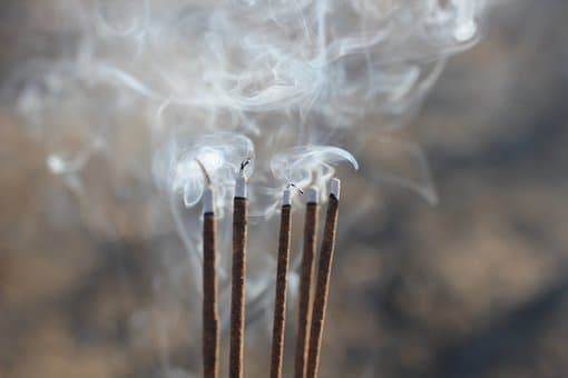 Incense burning in observance of Ghost Day