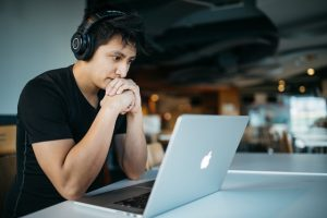 Chinese man looking a macbook learning Exceptions to Pinyin
